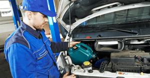 auto mechanic making repairs on a fleet vehicle