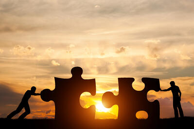 AdobeStock_109067861-giant puzzle peices at sunset