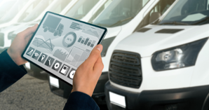 fleet manager holding a tablet with Fleet-management software to help manage his fleet of service vehicles.