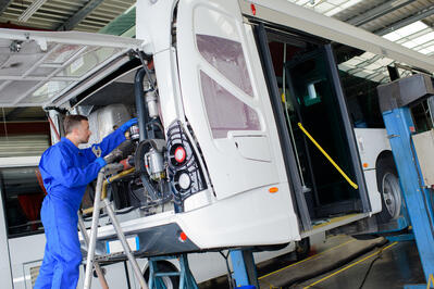 Mechanic Working On Bus  equipped with Coencorp's automatic vehicle data unit with no recurring fees