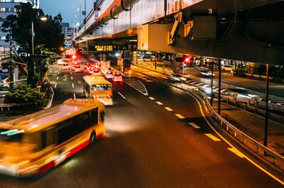 bus-rushing-by-on-city-street-in-evening-sm2-fuel-transit
