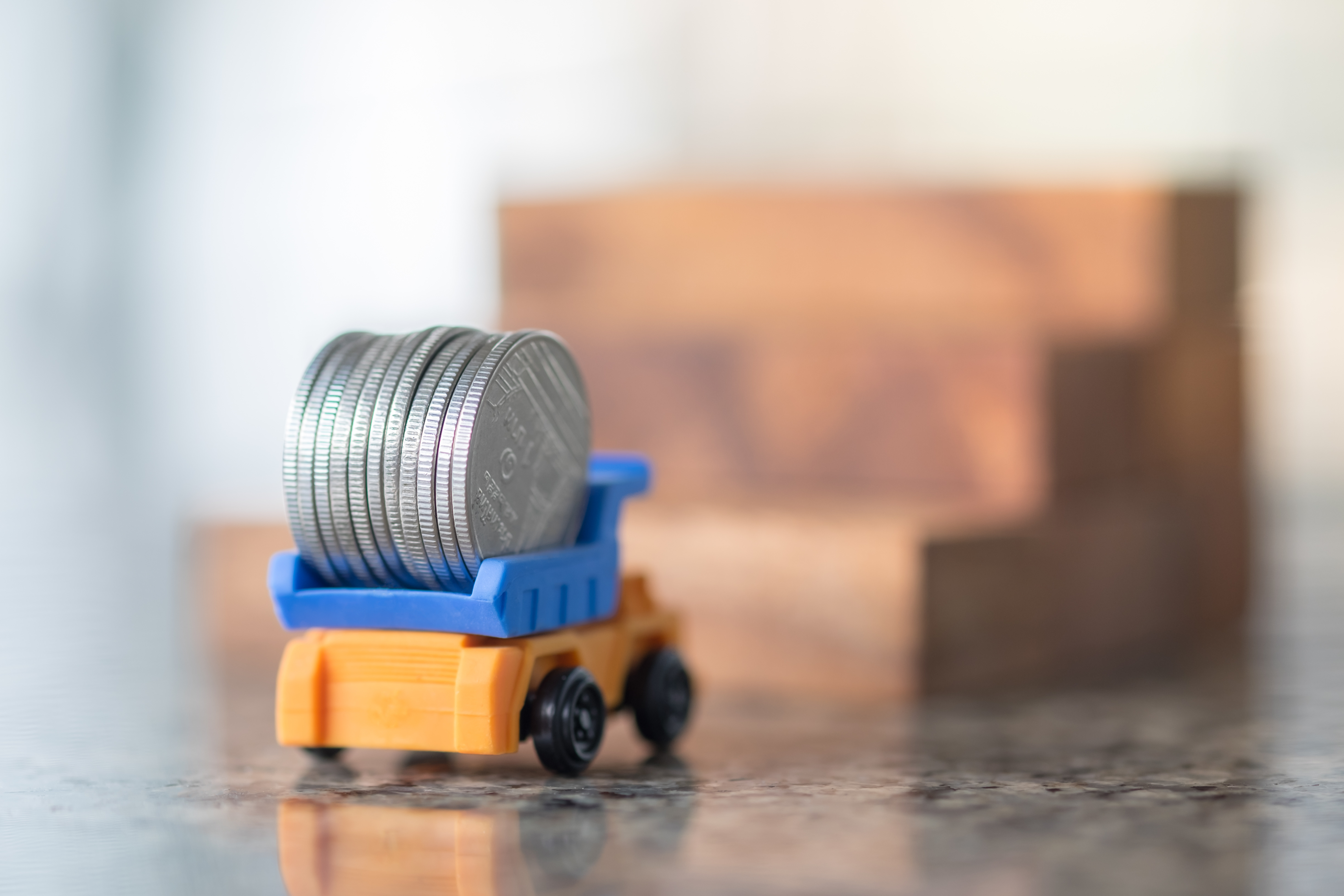 Toy Truck Carrying Coins-AdobeStock_196523697