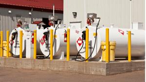 Yellow-safety-bollards-surrounding-above-ground-fuel-storage-tanks