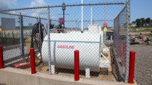 above-ground-storage-tank-fenced-to-prevent-theft-and-vandalism