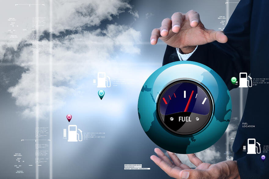 executive holding fuel gauge
