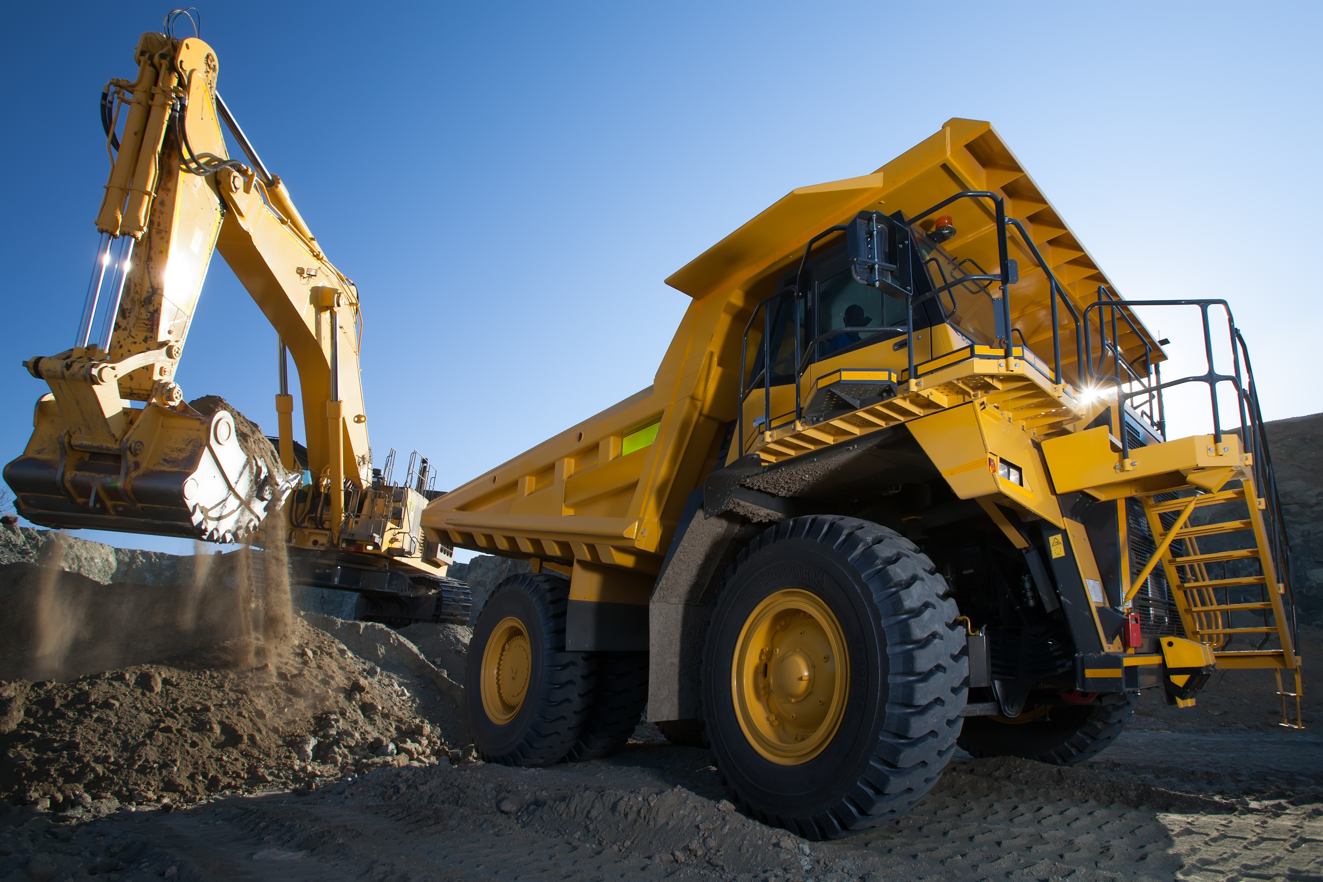 Image of open pit mining operations were equipment like loaders and trucks require mobile fueling operations.