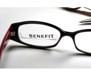 eye glasses highlihgting the word benefit on a piece of paper.