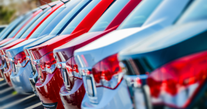 row of new vehicles- vehicle fleet specification and vehicle acquisition is often a challenge for fleet managers