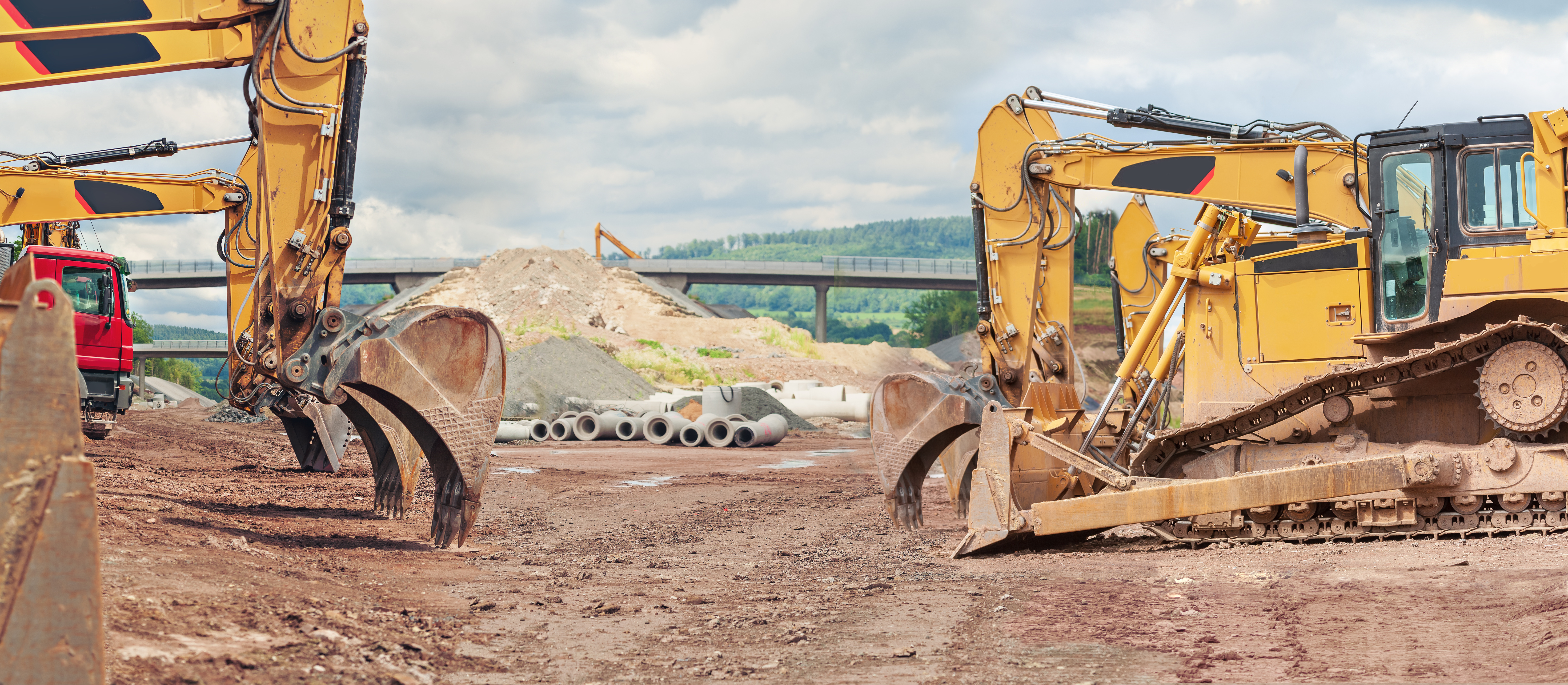 Construction equipment in a construction site signifying the need for accurate fuel control analysis.