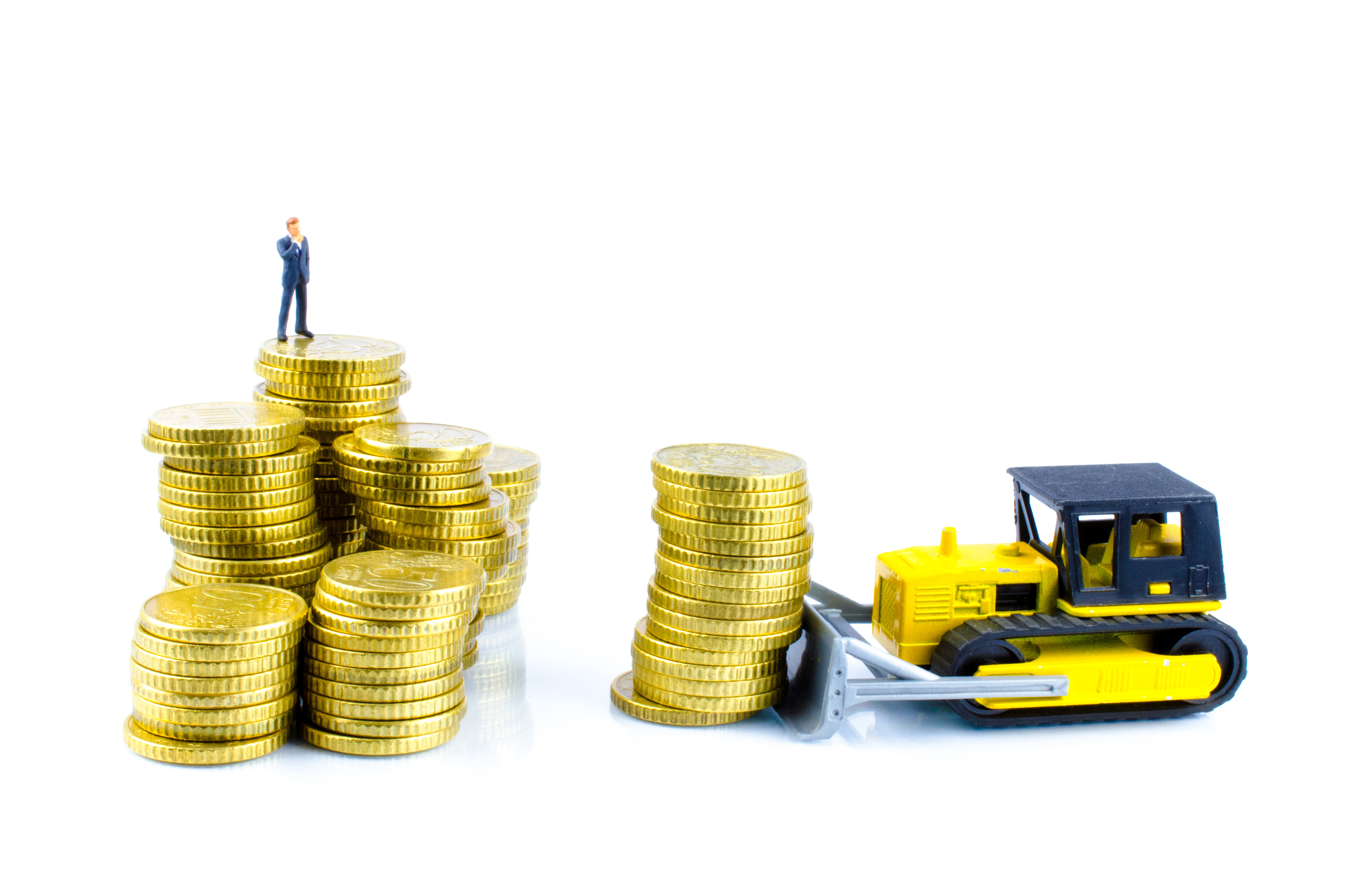 Businessman On A Pile Of Coins-AdobeStock_58347743